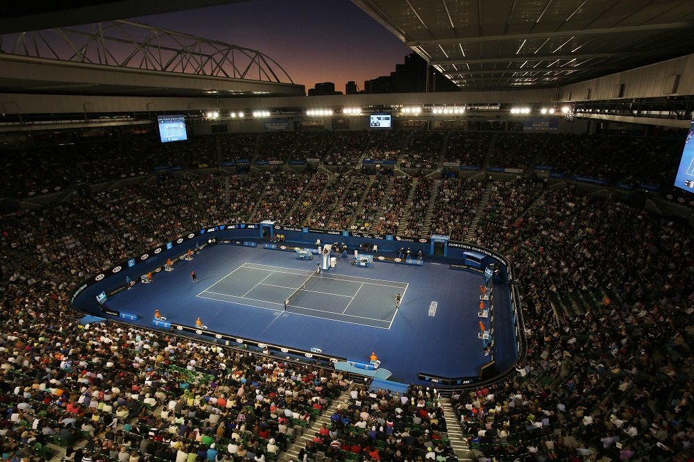 Australia's Lleyton Hewitt, right, and Serbia's Janko Tipsarevic play the opening night match on Rod Laver Arena in a first round match at the Australian Open tennis championship in Melbourne, Australia, Monday, Jan. 14, 2013. (AP Photo/Aaron Favila)